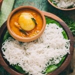 idiyappam or rice string hoppers served on wooden plate with egg stew