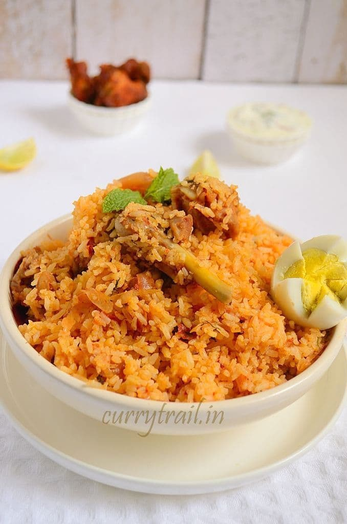 Ambur chicken biryani in a white bowl and boiled egg on top