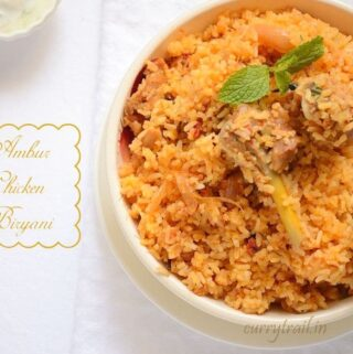 Ambur chicken biryani in a white bowl with chicken leg piece and boiled egg on top
