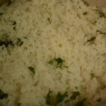 coriander leaves is added over jeera samba rice for ambur chicken biryani made in cooker