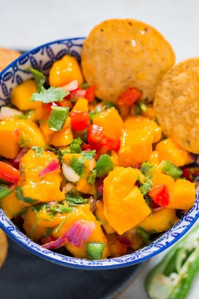 Fresh mango salsa recipe in a bowl bowl with nachos chips