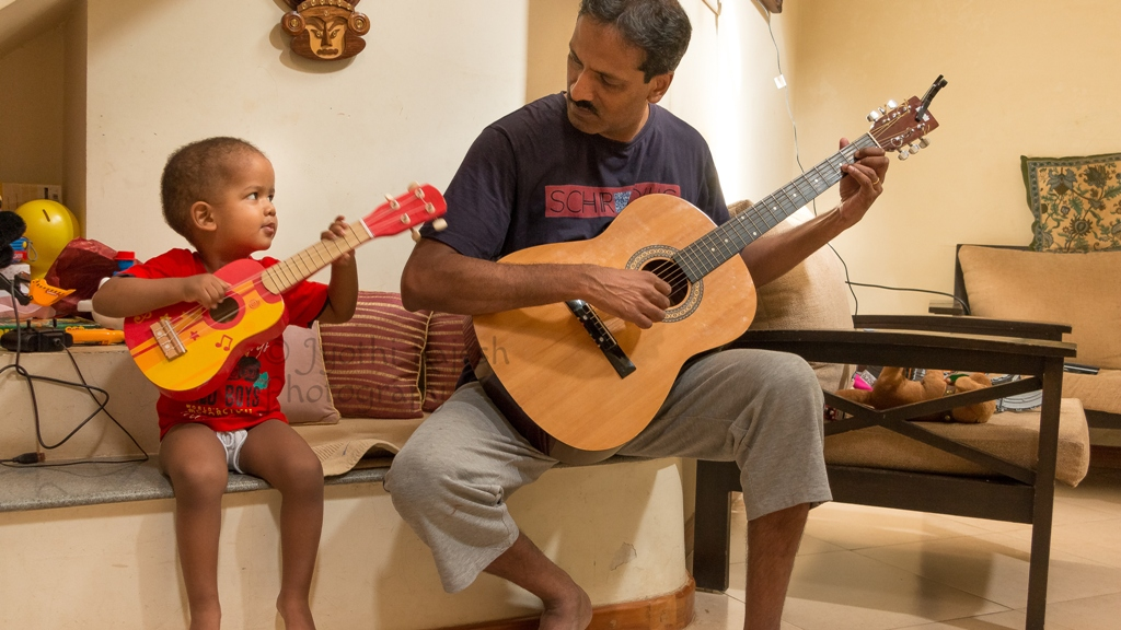 Family pic of hubby and son playing guitar