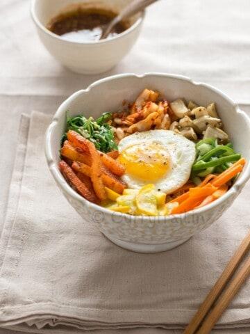 vegetarian Korean bibimbap with chop sticks on side