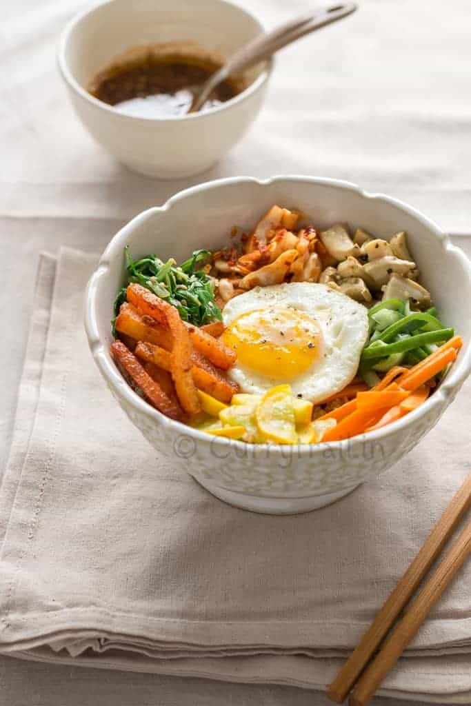 vegetarian Korean bibimbap with chop sticks on side