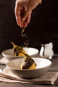 Spiced Orange Saffron Poached Pears with Chocolate Sauce and Pistachios Sand