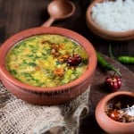 dal palak served in earthen pots is simple dal recipe with goodness of spinach