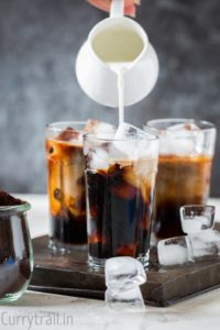 Pouring half and half for iced coffee recipe