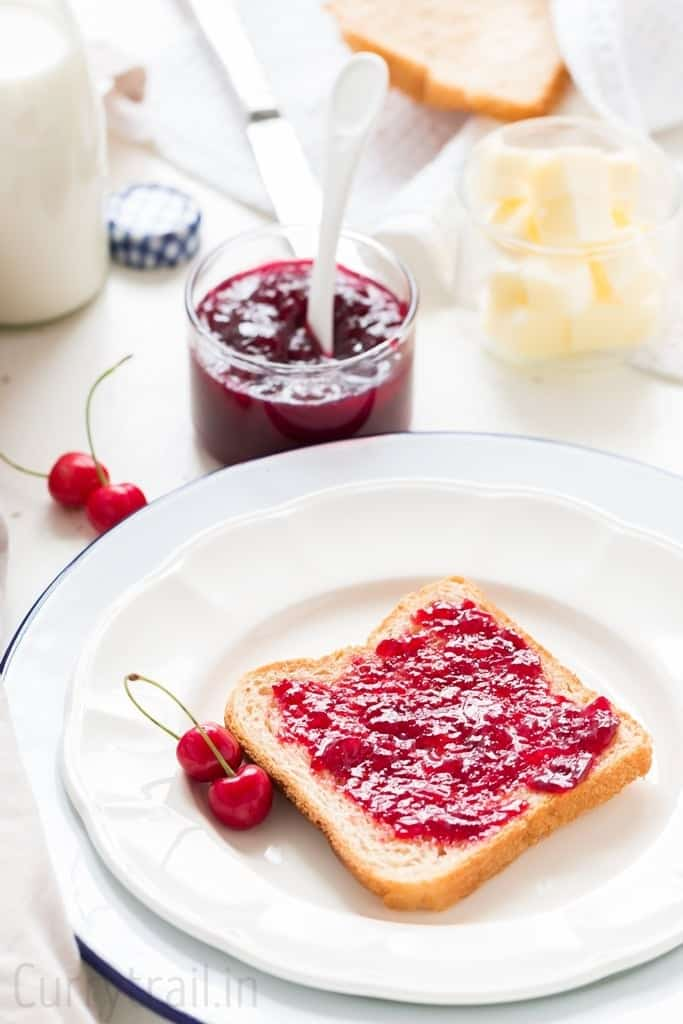 slice of bread smeared with homemade cherry jam