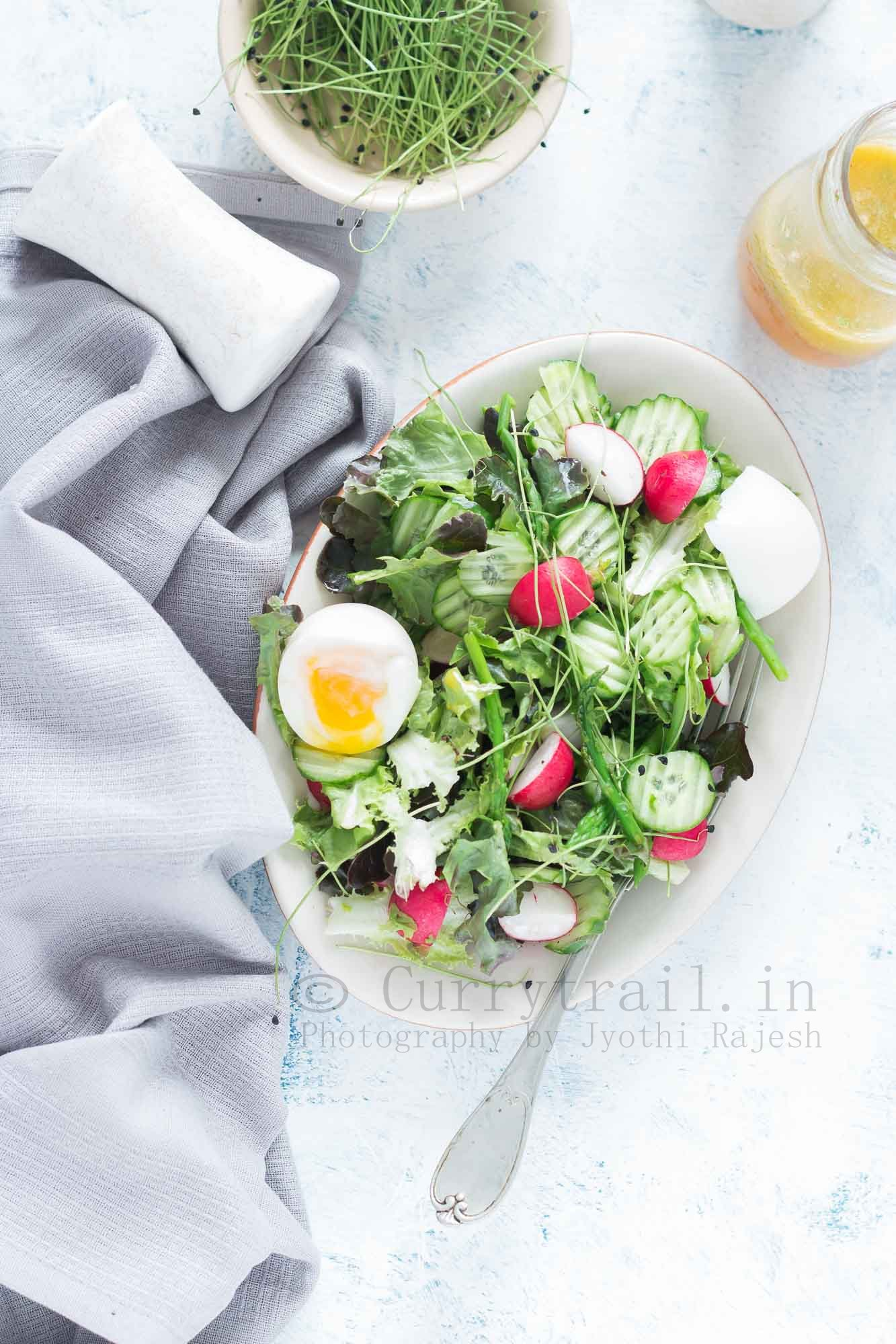 fresh spring salad made from fresh spring mix of tender greens with orange vinaigrette