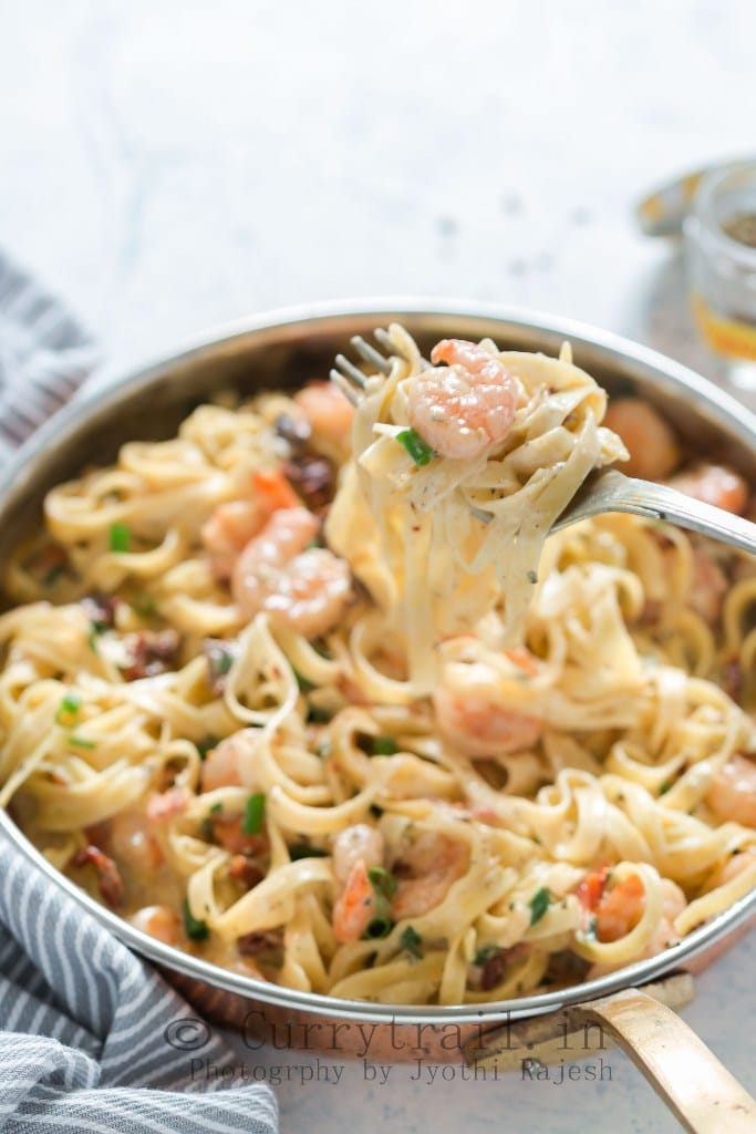 Garlic Shrimp Pasta in Creamy Sauce in a fork