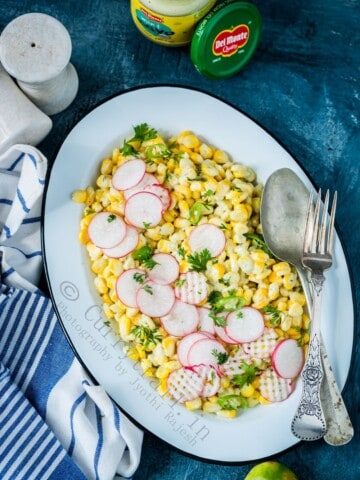 creamy corn salad with mayonnaise served in white plate