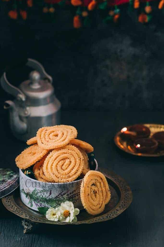 super crunchy butter murukku served in tin boxes