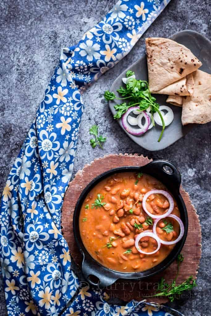 rajma masala is rich, creamy, spicy red bean curry served in cast iron pan