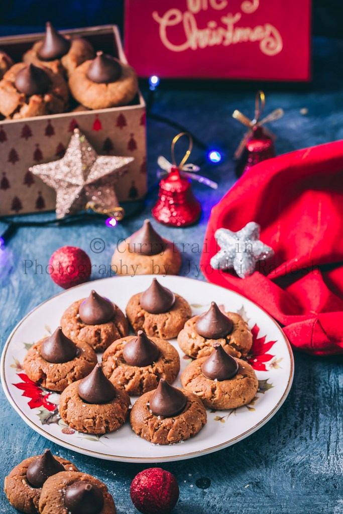 peanut butter kiss cookies are soft chewy cookies that's great for cookie exchange during the holidays. Soft cookies made of peanut butter and topped with chocolate kiss candy at the center is a classic holiday cookie