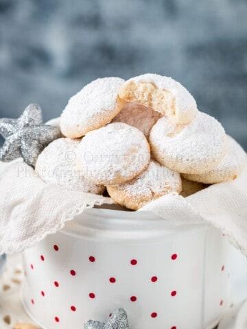 cashew snow cookies in white cookie jar