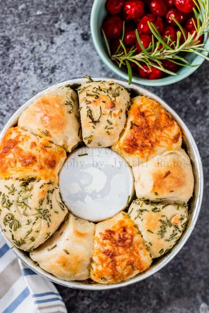 cheese herbs savory pull apart bread on baking dish