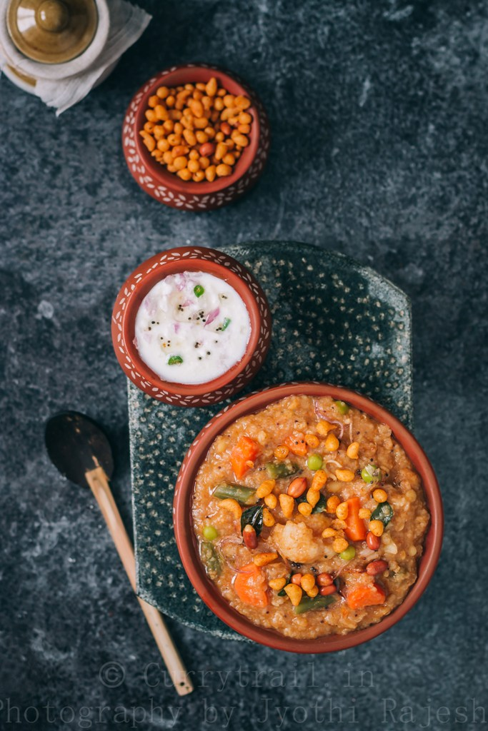 spicy bisi bele bath served with boondi and raita
