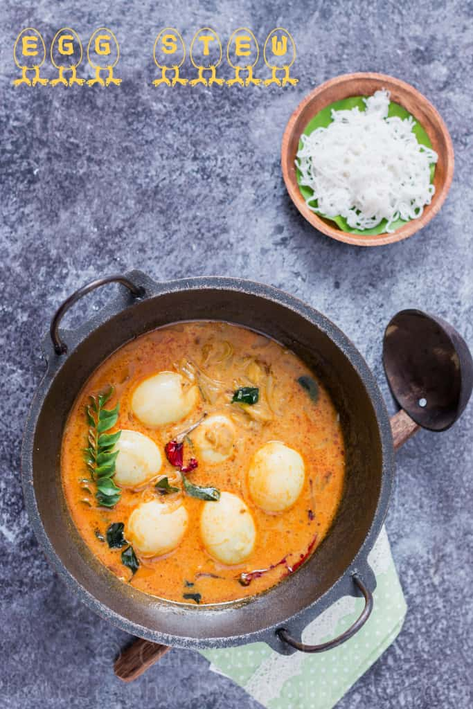egg stew Kerala style served in cast iron pan for breakfast with rice string hoppers