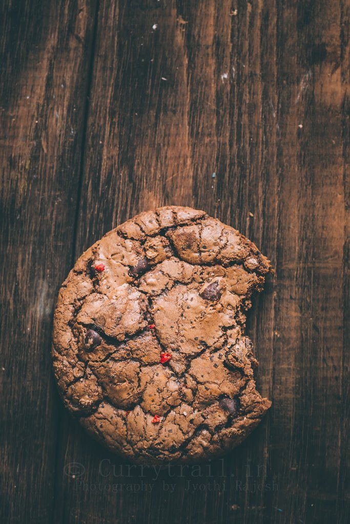close up view of dark chocolate chili cookies on rustic background