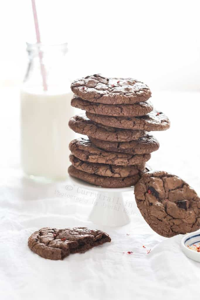 stacks of chocolate chili cookies with bottle of milk