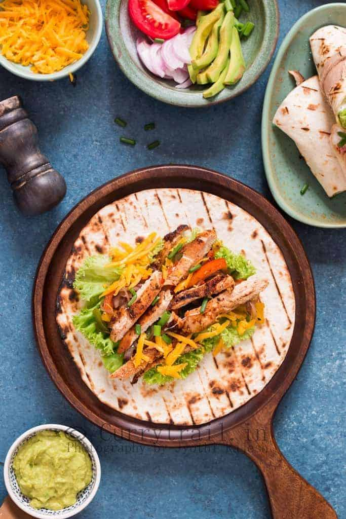 Chicken fajitas spread on flour tortillas