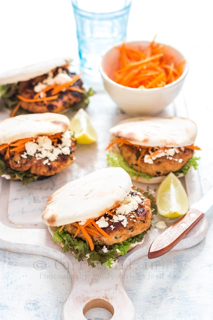 Moroccan Chicken Burgers Spread on a Boards with Bowl of Carrots