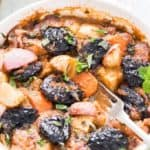 Vegetable tagine with prunes in white casserole