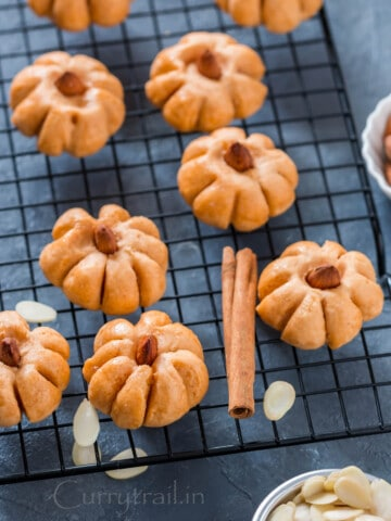 shaped like pumpkin - pumpkin cookies on wire mesh