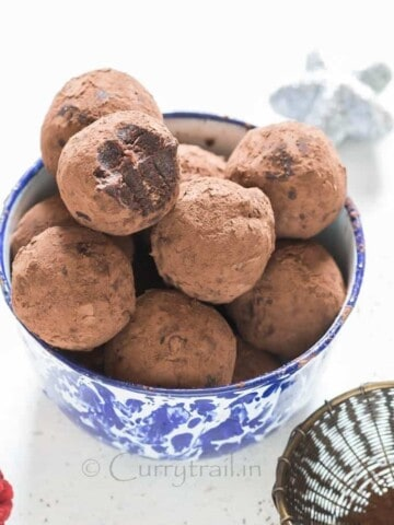 Christmas Rum Balls served in blue bowl is simple to make and guaranteed to wow your guests