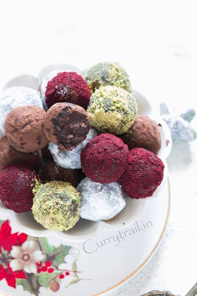 Christmas Rum Balls served in white bowl is simple to make and guaranteed to wow your guests