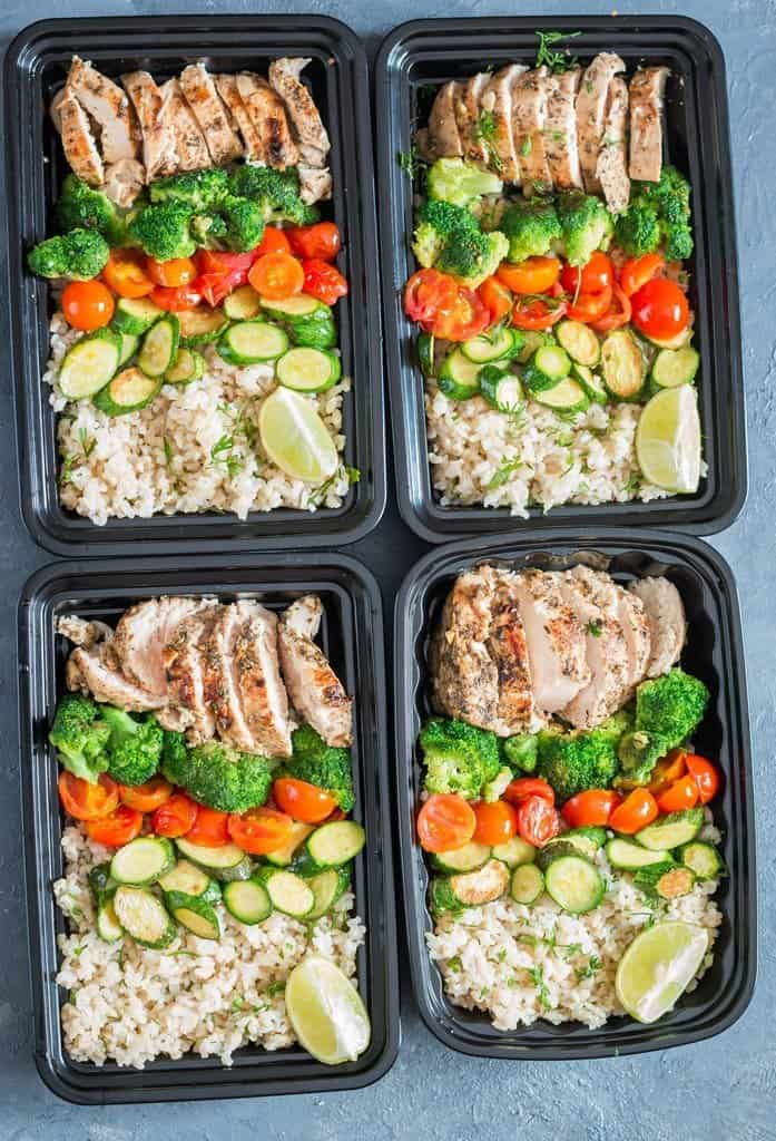 chicken meal prep with brown rice in four meal prep boxes