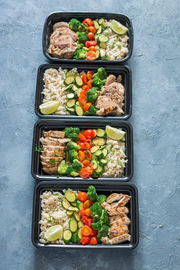 chicken meal prep with brown rice packed in plastic meal prep boxes