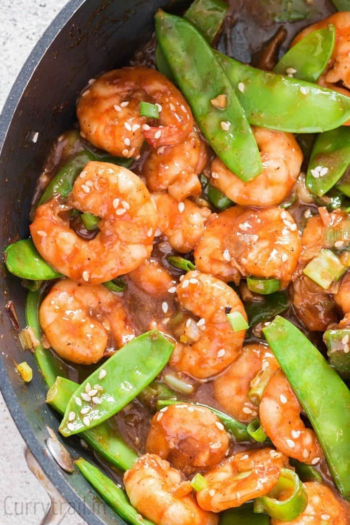 shrimp stir fry with snow peas close up view