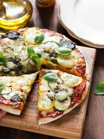 Zucchini Pizza Slice Hand Picking It Up