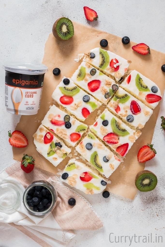 Sliced frozen yogurt bark on parchment paper