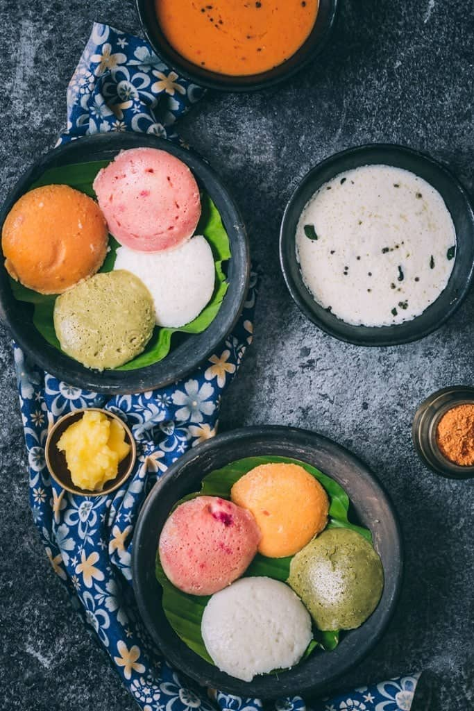 all natural colorful idli with coconut chutney and tomato onion chutney