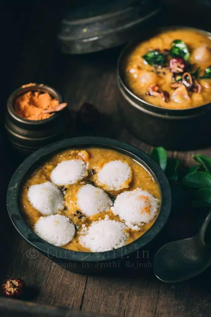 Tiffin sambar idli in a rustic bowl