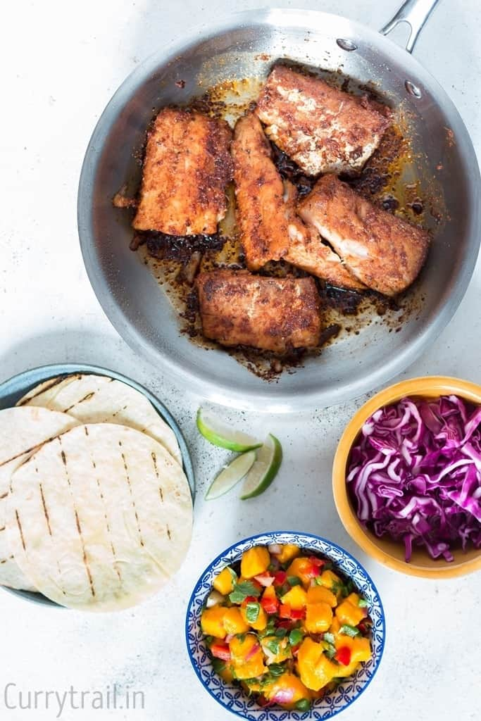 All toppings readily placed in bowls for making tilapia fish tacos recipe