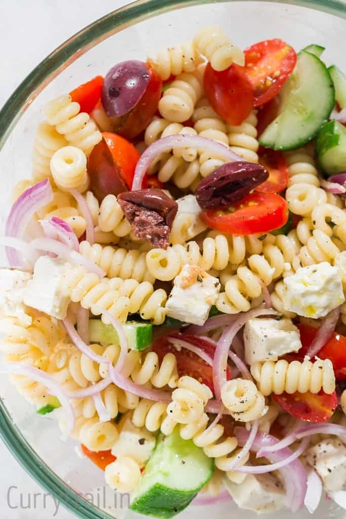 close up of Greek pasta salad in a bowl