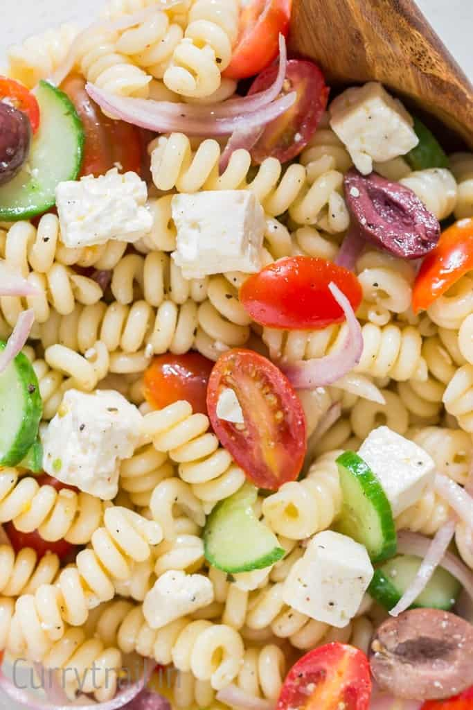 close up of pasta salad with feta and olives