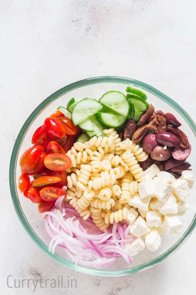 Ingredients for Greek pasta salad in a bowl