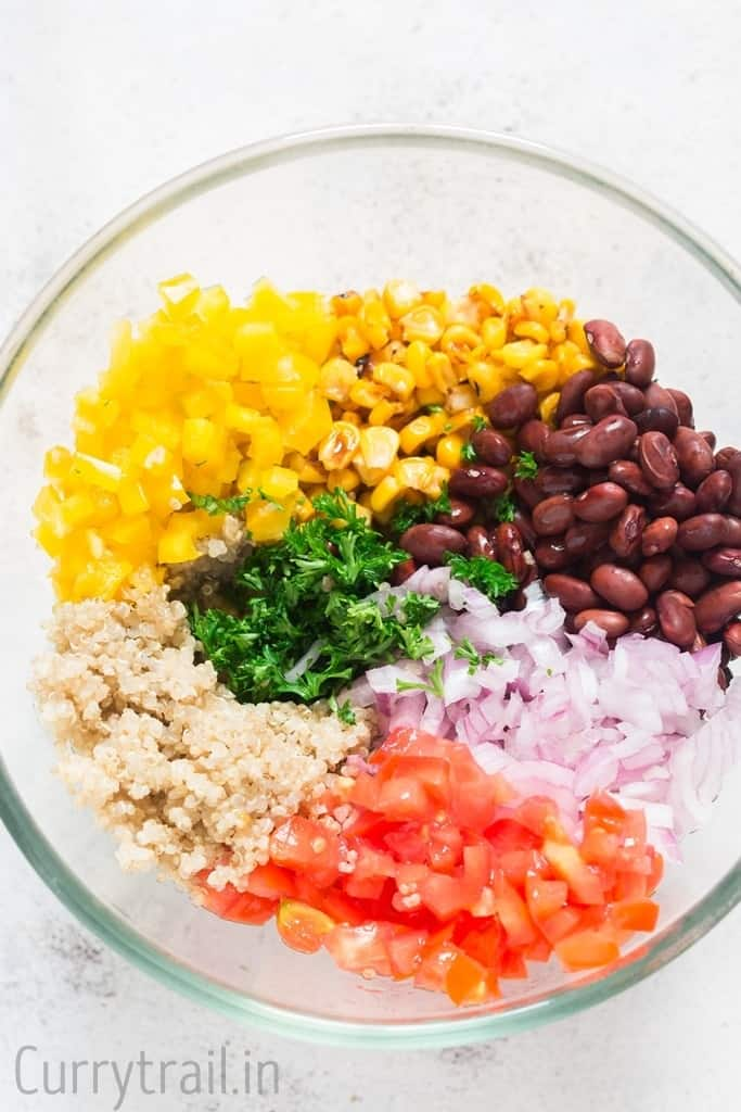 Ingredients for Mexican quinoa salad bowl in a glass bowl