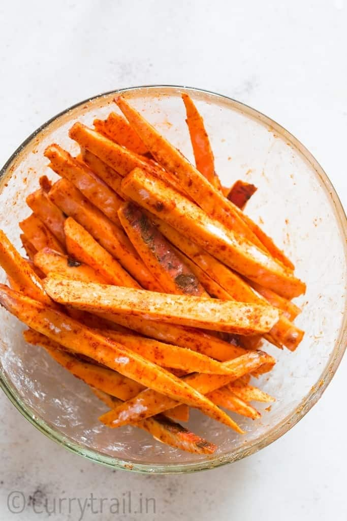 potato fingers in glass bowl for baked sweet potato fries