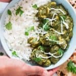 instant pot chicken saag with rice in a bowl and rotis on side