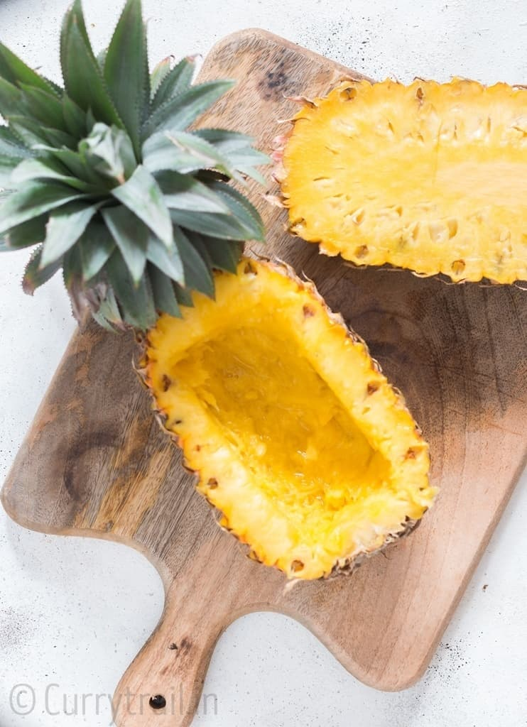 Fresh pineapple cut half into pineapple bowl