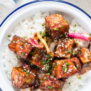 general tso's tofu served with rice in white plate