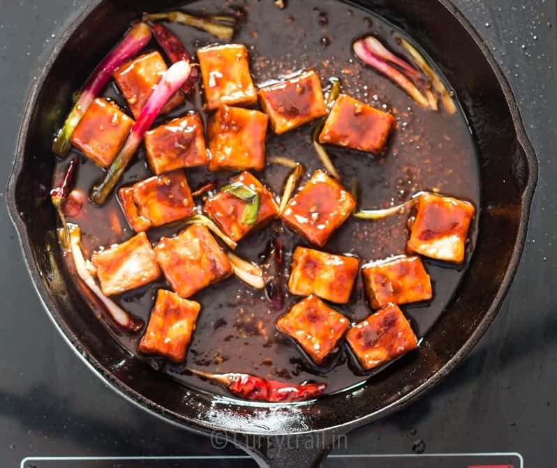 general tso's tofu cooked in cast iron pan