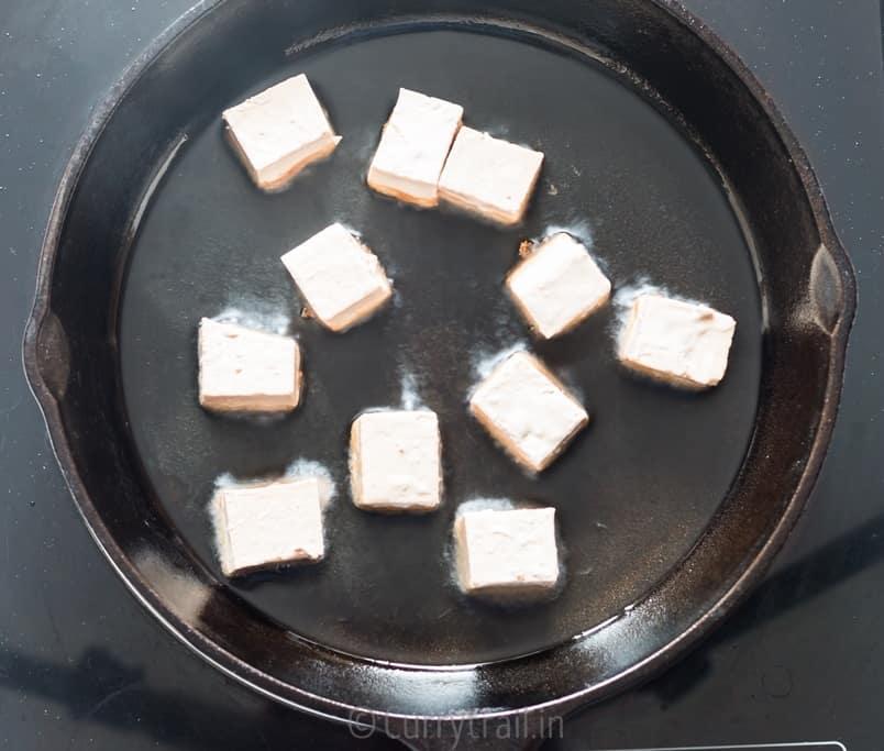 Frying marinated tofu cubes for general tso's tofu