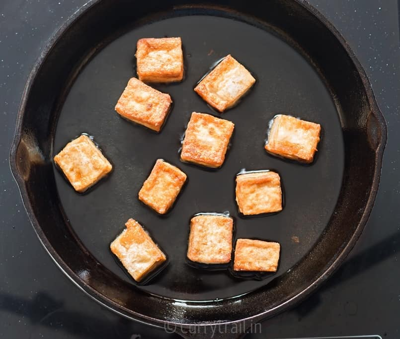 Frying marinated tofu cubes for general tso's tofu