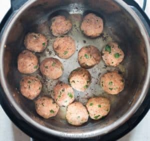 Instant pot chicken Parmesan meatballs sauteing meatballs in instant pot